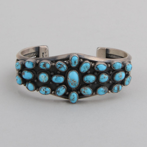 Sterling silver cuff with open rope work on the sides.  Excellent silver work and gem quality Persian Turquoise make this cuff a knock out!