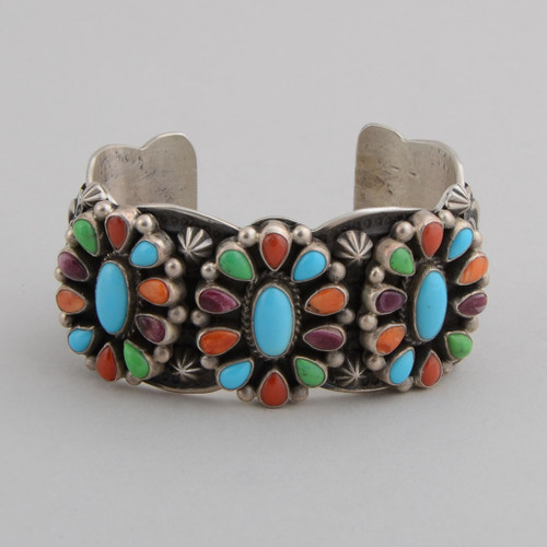 """Classical Navajo """"daisies"""" with color.  The stamp work and bright colors make this cuff a knock out!"""