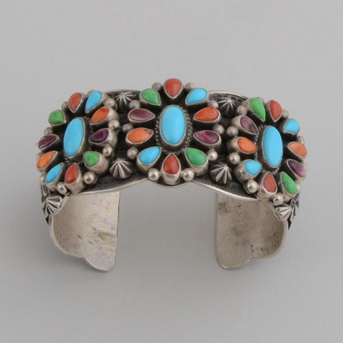 "Classical Navajo ""daisies"" with color.  The stamp work and bright colors make this cuff a knock out!"