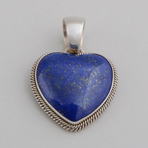 Sterling Silver Pendant w/ Lapis Lazuli. Heart shape Design and Detailed Silver work.