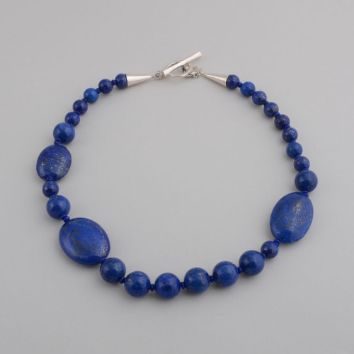 This Peyote Bird necklace is stunning Lapis, interesting with the two different cut beads.