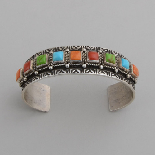 Sterling silver cuff with raised multi colored stones.