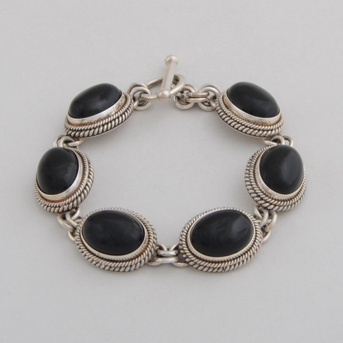 Sterling Silver Link Bracelet w/ Black Onyx , 6 Oval Stones and Detailed Silver Work. Toggle Clasp.