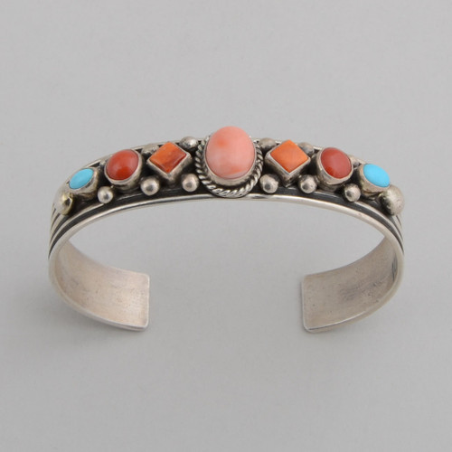 Slender Sterling silver cuff with coral and other stones.