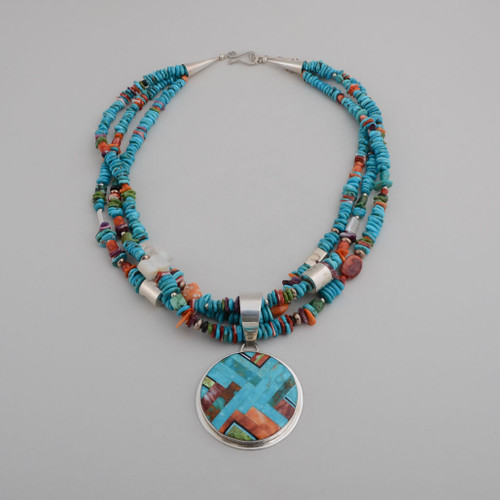 Sterling Silver Pendant Inlaid with Various Shades of Turquoise and Purple and Orange Spiney Oyster Shell.  Three Strands of Beads Have Sterling Silver Beads, Turquoise, Spiney Oyster Shell, Fresh Water Pearls, and a Bear.  Pendant Can Be Removed From Beads.