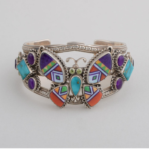Sterling Silver Cuff with Inlaid Butterfly and Accent Stones.  Butterfly is Done with Hand Cut Stone to Stone Inlay.  Stones Include Sugilite, Shell, Red Coral, Natural Opal, Turquoise, Amethyst, Peridot.