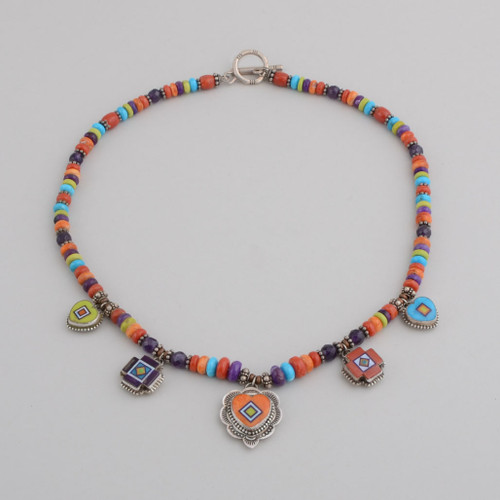 ClaspSterling Silver with Inlay Hearts and Directional Symbols.  Hand Cut Stone to Stone Inlay.  Stones Include Pixie Turquoise, Orvil Jack Turquoise, Red Coral, Orange Spiny Oyster Shell, Sugilite, Natural Opal.  Multi-Colored Beads With Clasp.