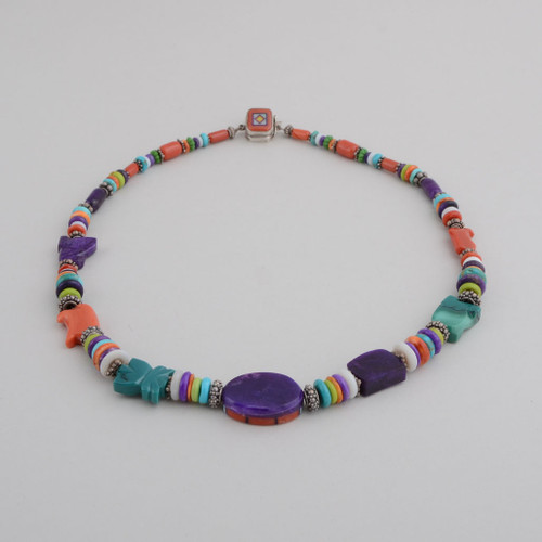 Hand Rolled Beads with Multi-Colored Stones.  Hand Cut, Stone to Stone Inlay.  Stones Include Red Coral, Natural Opal, Sugilite, Turquoise, Orange Spiny Oyster Shell Center Bead and Clasp are Inlaid.  Clasp is a Box Clasp