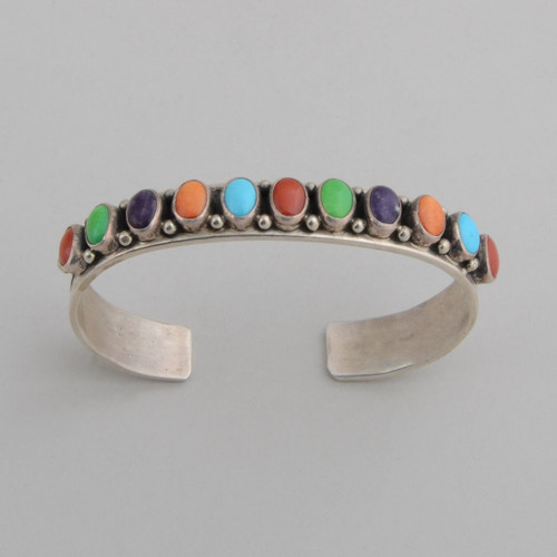Slender sterling silver cuff with oval shaped multi stones.