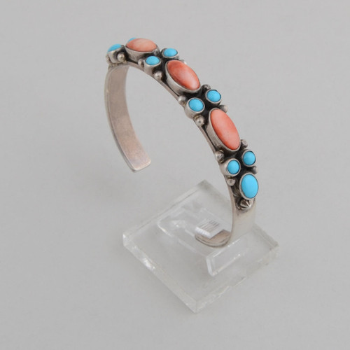 Slender sterling silver  cuff with Turquoise and orange spiny oyster shell.