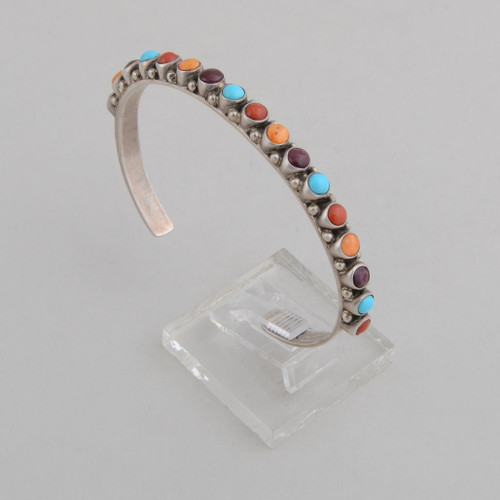 Slender sterling silver cuff with coral, orange spiny oyster shell,, sugilite, and Turquoise