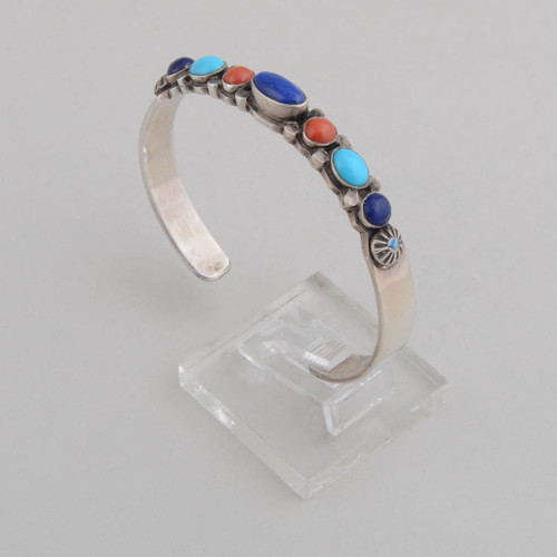 Slender sterling silver cuff with lapis lazuli, Turquoise, and coral.