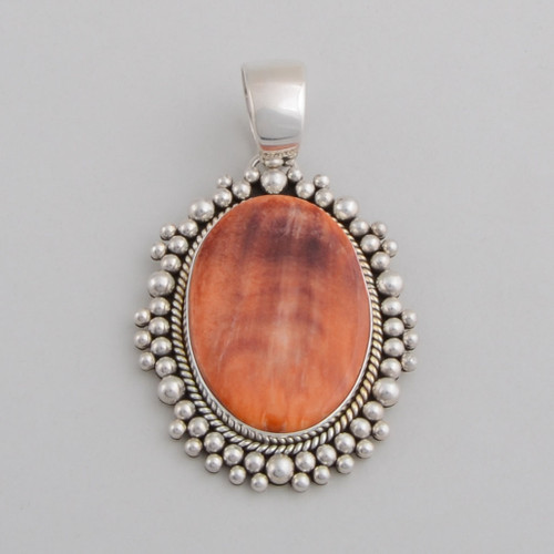 This Artie Yellowhorse Spiny Oyster Shell pendant has very interesting color variation in it!