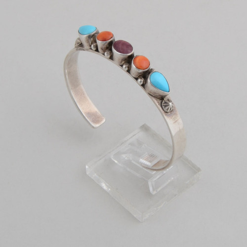 Slender cuff with turquoise, orange spiny and purple spiny oyster shell.