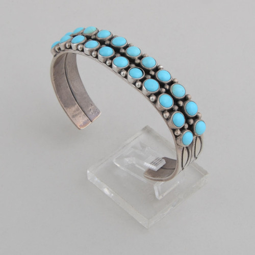 "Sterling silver cuff with stamp work on sides and a double row of Turquoise""dots""."