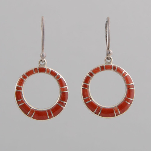 These Peyote Bird earrings feature Coral and Sterling Silver!