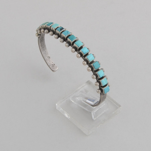 Slender sterling silver single row cuff with square cut Turquoise.