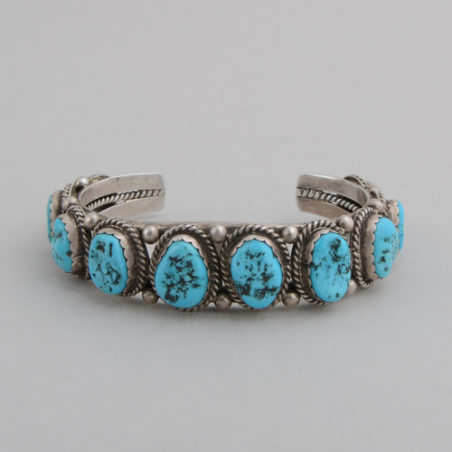 Slender sterling silver cuff with nugget style Turquoise stones almost all the way around.