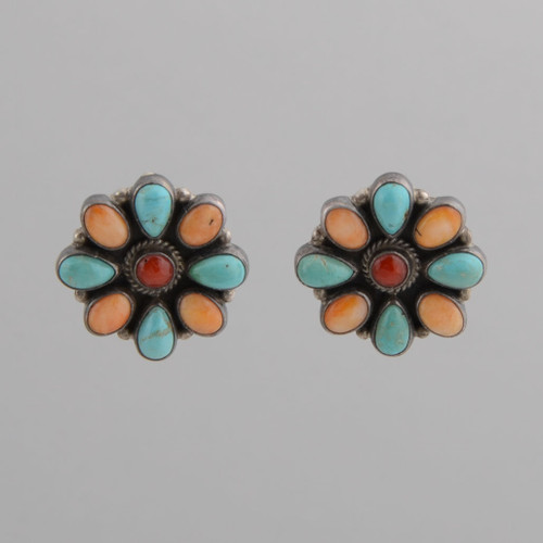 This pair of earrings features Spiny Oyster Shell, Turquoise, and Coral set in Sterling Silver.