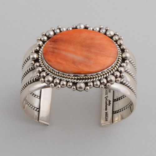 This Artie Yellowhorse Spiny Oyster Shell bracelet is set with such detail in the silver work it really pops!