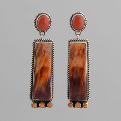 This pair of earrings features Orange Spiny Oyster Shell set in Sterling Silver.
