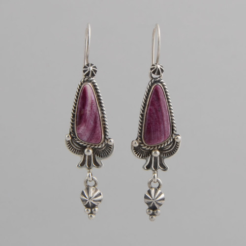 This pair of earrings features Spiny Oyster Shell set in Sterling Silver.