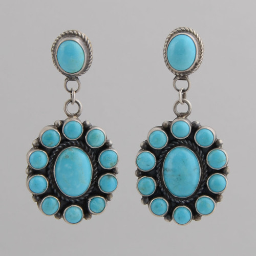 This pair of earrings features Turquoise set in Sterling Silver.