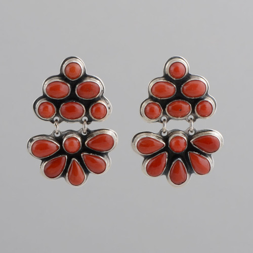 This pair of earrings features Coral set in Sterling Silver.