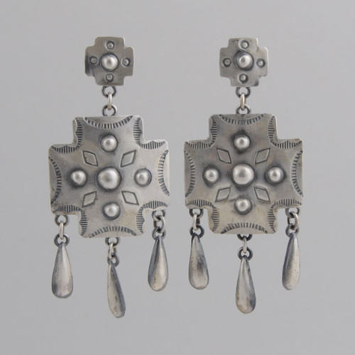 This pair of earrings features beautiful Sterling Silver work.