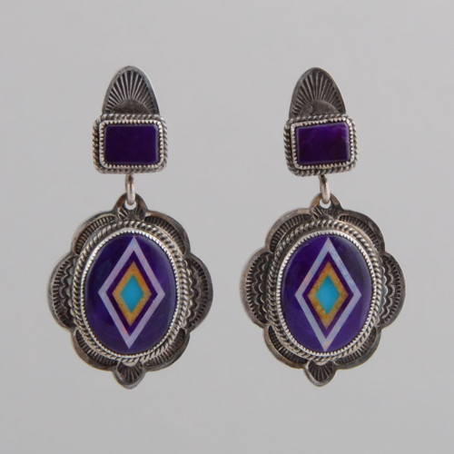 Magnificent sugilite ovals with bright inlay swing from sugilite posts.  The silver work gives a nice balance.