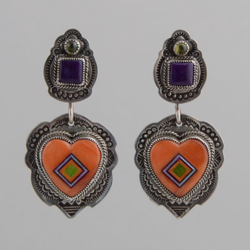 Peridot and sugilite top these inlaid coral heart earrings. They have nice movement and good balance with the silver work.