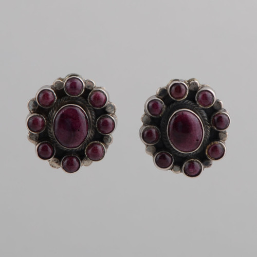 This pair of earrings features beautiful Spiny Oyster Shell and Sterling Silver work.