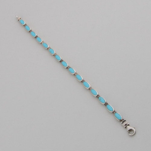 This reversible Peyote Bird Link Bracelet features Turquoise and Onyx set in Sterling Silver.