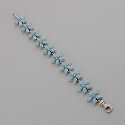 This Peyote Bird Link Bracelet features Lab Opal set in Sterling Silver.