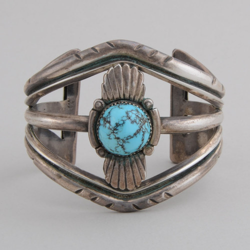This wonderful High Dome Persian  Turquoise Cuff Bracelet by an Unknown Artists dates back to the 70's.