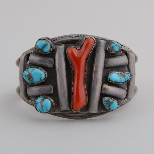 This wonderful 1970's vintage bracelet showcases beautiful Bisbee Mine Turquoise as-well-as Red Coral and Sterling Silver.