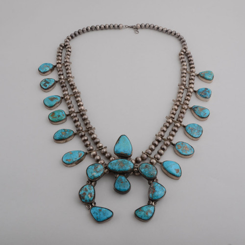 This beautiful Morenci Turquoise vintage squash has hand made silver beads and more!