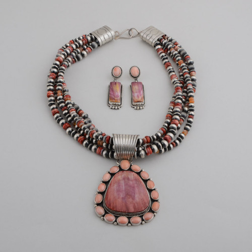 This necklace and earring set by La Rose Ganadonegro is stunning with the mixture of Purple Spiny Oyster and Pink Coral in the pendant and earrings, and the beads with Red Spiny and Silver accents.  The 5 strands of beads can be worn separately.