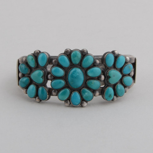 "Beautiful gem quality Blue Gem Turquoise cuff, set in Coin Silver!  Nice detail with the Turquoise hearts in the side ""flowers."""