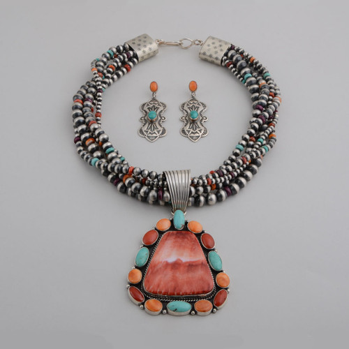 What a statement this necklace & earring set by La Rose Ganadonegro makes! The detachable beads are Sterling Silver, Orange, Red & Purple Spiny Oyster and Turquoise, The pendant & earring have Orange Spiny, Red Coral and Sleeping Beauty Turquoise.