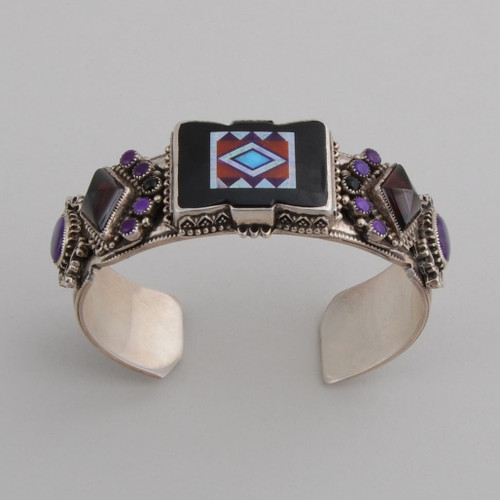 Bold cuff inlaid with colors over black;magnificent silver work!