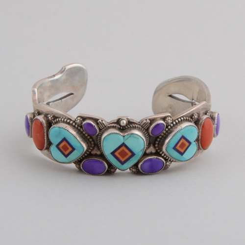 Sugilite and coral accent this sterling silver cuff with turquoise inlaid hearts.
