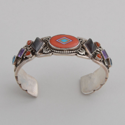Colorful gemstones add nice accent to the beautiful inlaid coral on this cuff.