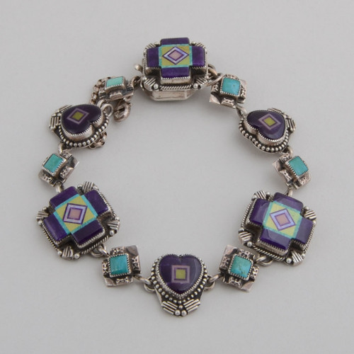 Inlaid sugilite Four Directions and hearts with diamond shaped turquoise between the sterling silver links.