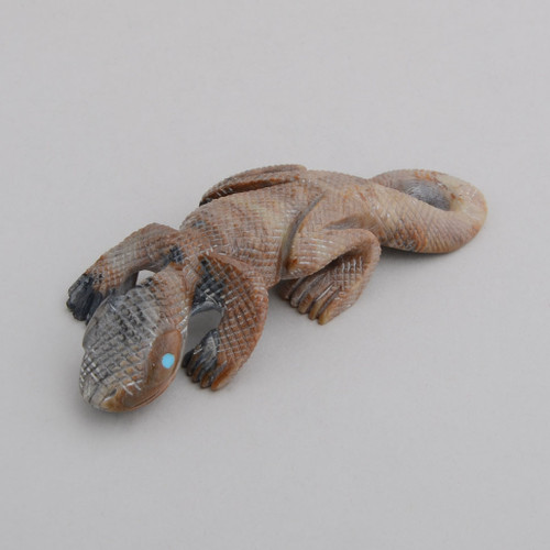Detailed carved lizard fetish.