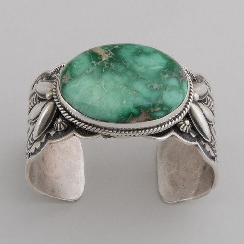 Bold Statement Piece.  Broken Arrow Turquoise, with very nice stamped and repousse sterling silver.