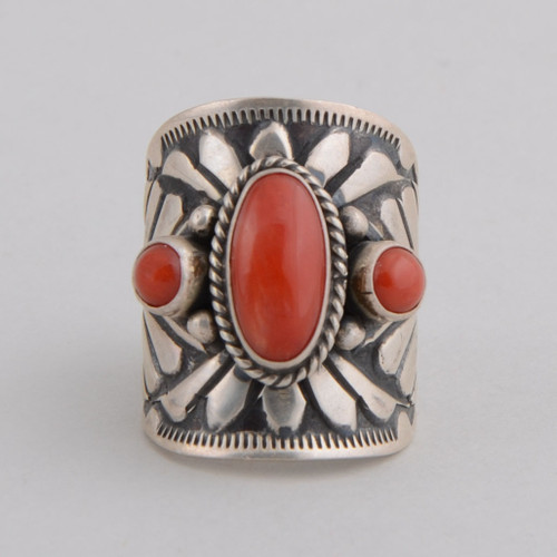 Red coral set in a cigar band style ring.