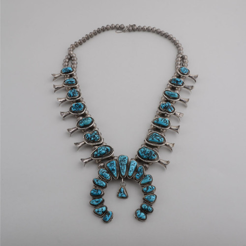Beautiful 1950s vintage squash blossom necklace featuring handmade beads, Kingman Turquoise and sterling silver!