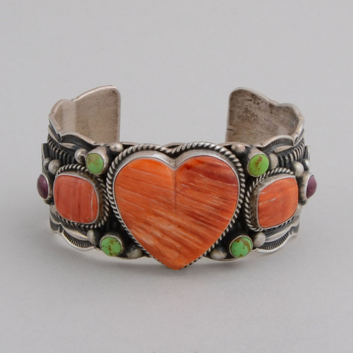 Tradition stamp work and repousse in sterling silver showcase a beautiful Orange Spiny Oyster Shell Heart with accents of gaspeite and purple spiny oyster shell.