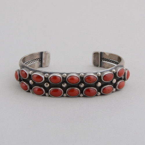"Sterling silver cuff with traditional ""rope"" work and deep red coral."